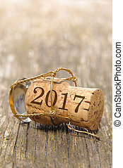 cork of champagne printed with new years date 2017 on it -...