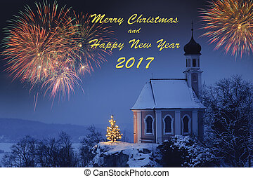 fireworks over romantic chapel in Bavaria at xmas and new year