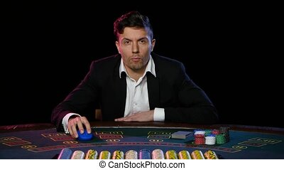 Man in a casino winning on the roulette. Close up