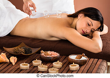 Woman Receiving Cupping Treatment On Back - Happy Young...