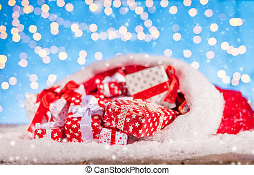 Santa bag with pile of gifts - Christmas background with...