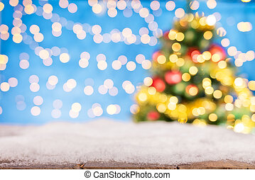 Blurred abstract golden spot lights with christmas tree....