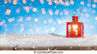 Christmas background with red lantern, blur abstract blue...