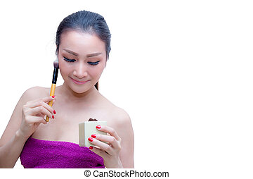 Closeup portrait of a asian woman applying dry cosmetic...