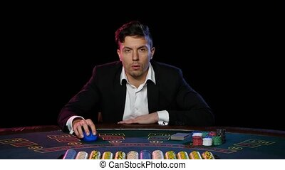 Online poker player is happy about winning in the casino....