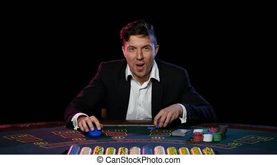 Winning online poker player at the table in the casino....