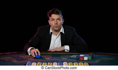 Online poker player with cards and chips at casino. Close up...