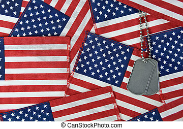 dog tags on American flag collage - military dog tags on...