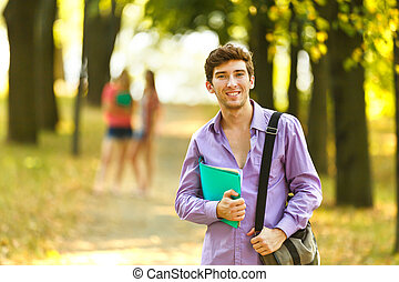 successful student with books in the Par