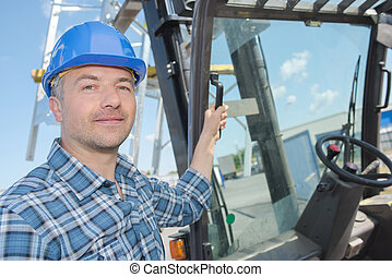 Portrait of fork lift driver