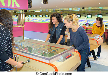 Women playing table football