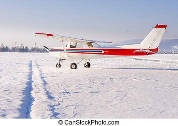 Small sports plane in winter at snow covered airport - Small...