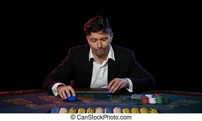 Online poker player with chips and winning at casino table. Close up