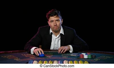 Lose the game of online poker. Close up - Man loses the game...