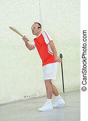Man playing racket sport