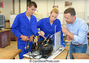 Students working with radiator components
