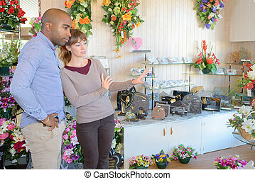 Vendor showing flowers for gravestones