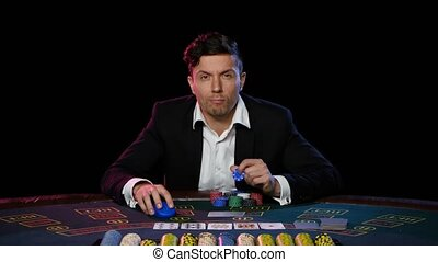Online poker player has won at the casino. Close up - Young...