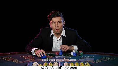 Online poker player losing. Close up - Casino player loses...