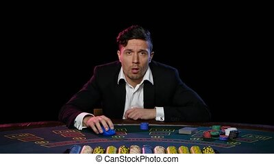Successful online poker player wins. Close up - Man playing...