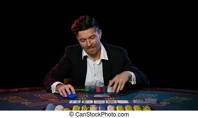Winning player in the online poker. Close up - Man plays...