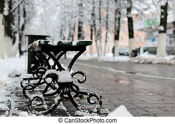 bench winter sidewalk