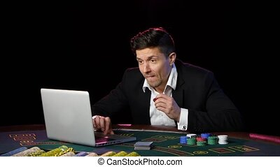 Poker player gambling on online casino and lossing. Close up...