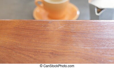 Serving hot espresso cup on wooden table, stock video