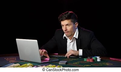 Man gamble in online casinos and lossing. Close up - Poker...