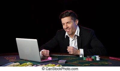 Man playing poker online and loses. Close up - Poker player...
