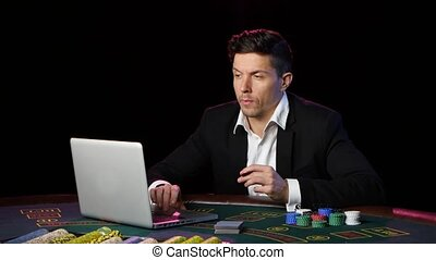 Gambling in online casino. Close up - A man in a suit...