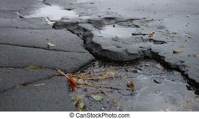 bad asphalt pit is big puddle rain outdoor road - bad...