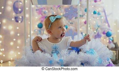Little girl fun christmas tree