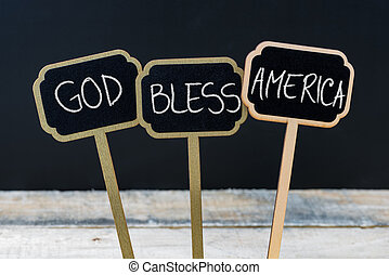 Concept message GOD BLESS AMERICA written with chalk