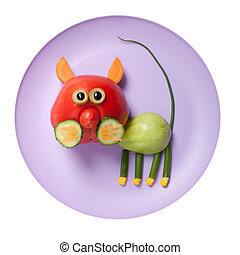 Cat made of red and green tomato on plate