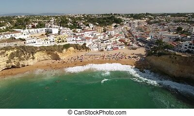 Aerial. Beach Carvoeiro from the sky in the summer. Portugal