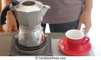 Hot coffee stream flowing out from moka pot, stock video