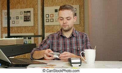 Man pays customer purchase cards in the office using the...