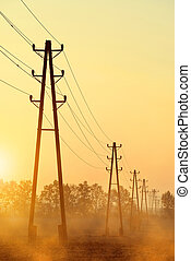 Electricity transmission pylons at sunset.