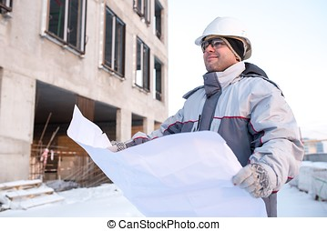 Civil Engineer At Construction Site In Winter - Civil...