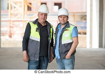 Civil Engineer And Foreman At Construction Site - Civil...