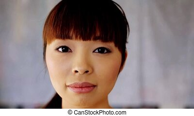 face of happy smiling asian young woman - race, ethnicity,...