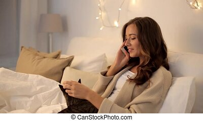 happy young woman calling on smartphone at home -...