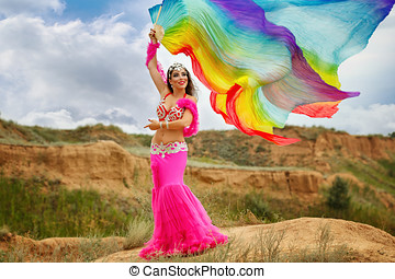 Girl dancing belly dance with a shawl - Oriental Beauty...