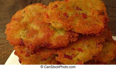 Delicious homemade potato pancakes on wooden board
