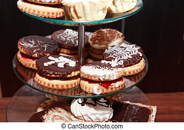 Cupcake Stand On Dark - Set of various cakes on stand...