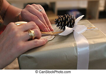 Luxury gift unwrapping - Ladies hands, with gold jewelry,...