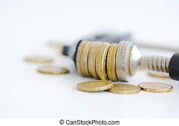Economy pressure concept with stack of coins in a cramp