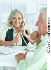 Senior businesswoman with phone - Senior businesswoman...