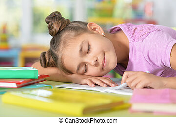 Cule girl fell asleep while she was doing her homework